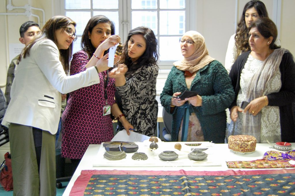 Community on Solid Ground women's group and British Museum curator Fahmida Suleman exchange information about British Museum South Asian collection